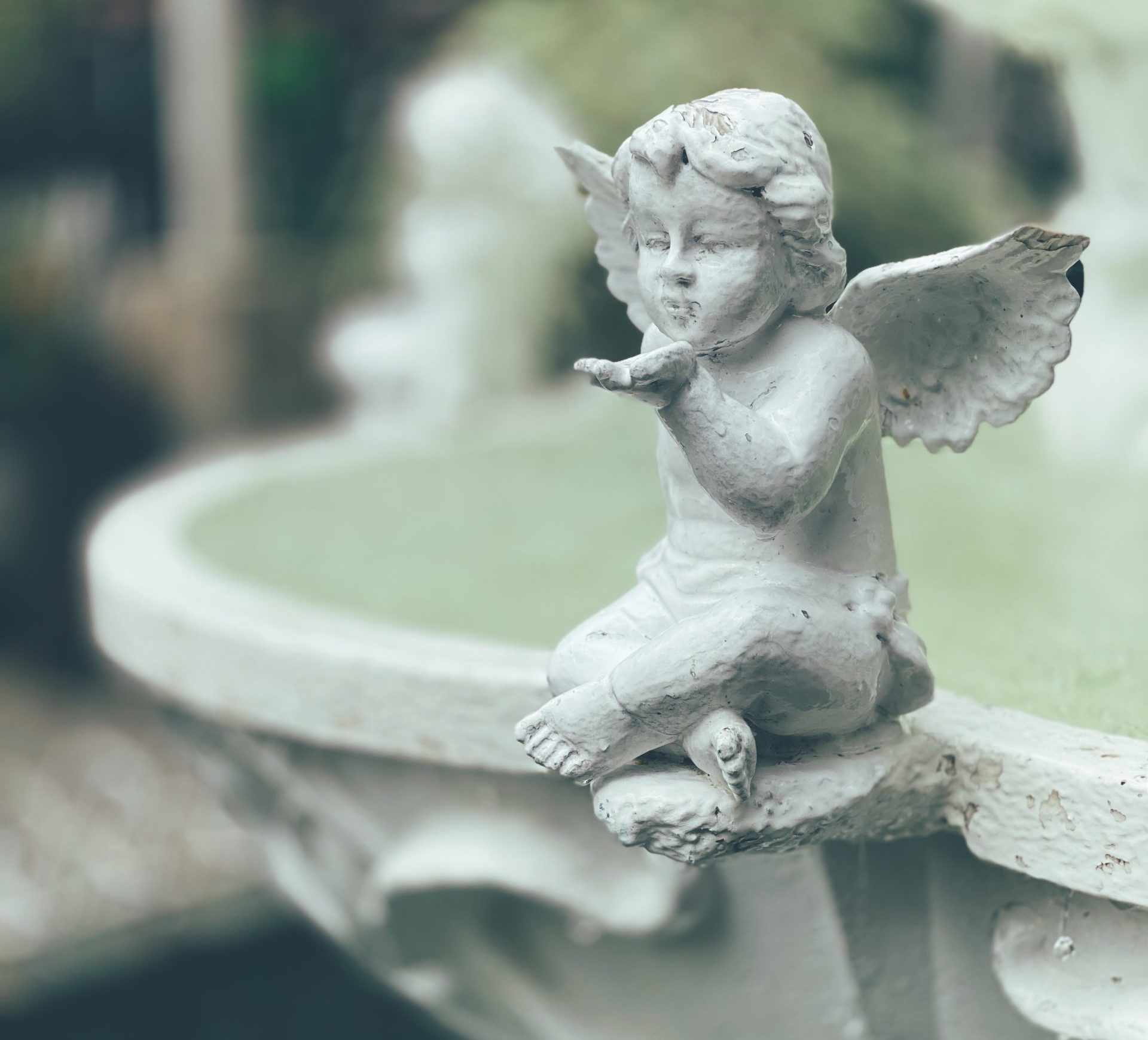 Angels in a fountain by CC Lozano