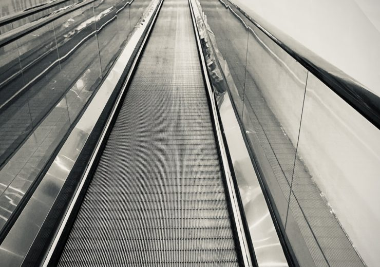 Walking in solitude at the mall during the pandemic by CC Lozano